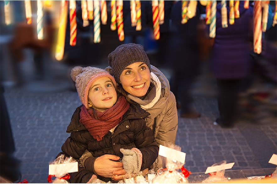 Mother and child at Christmas market