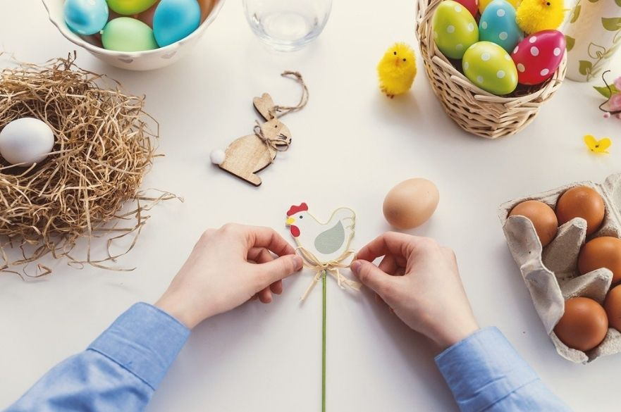 person creating easter decorations.