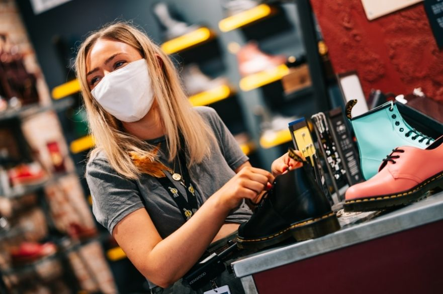 shop worker in mask