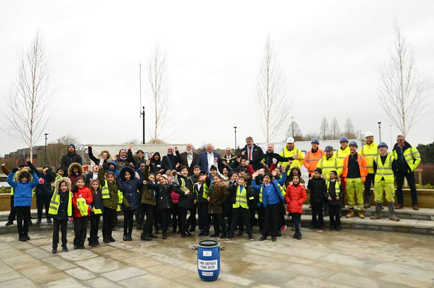 Children and council workers with time capsule