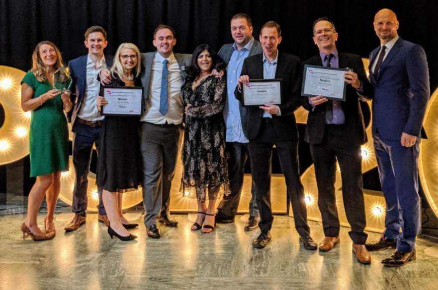 Council staff holding awards