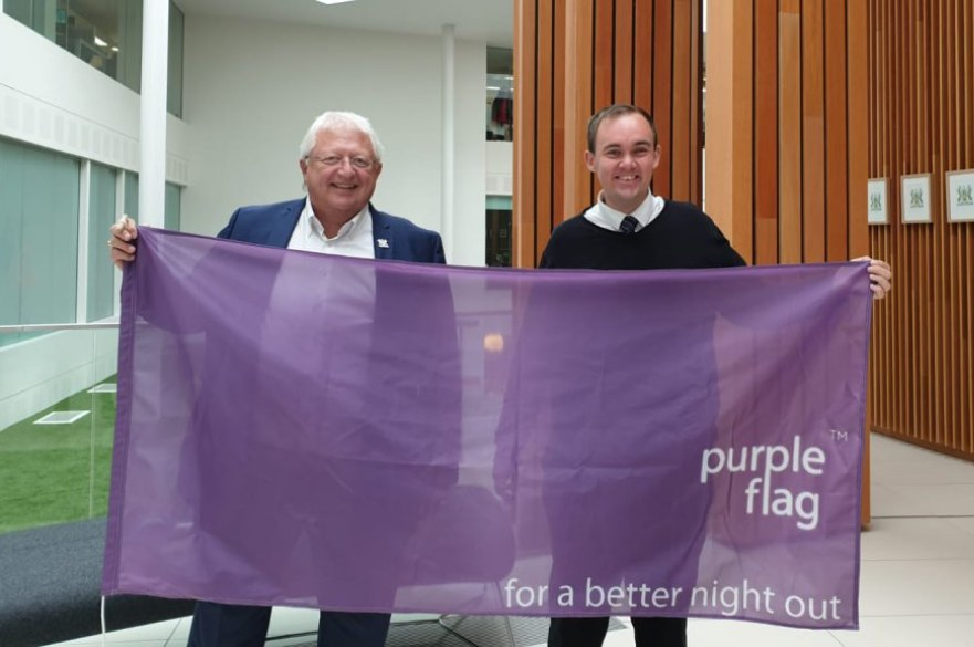 Councillors holding purple flag