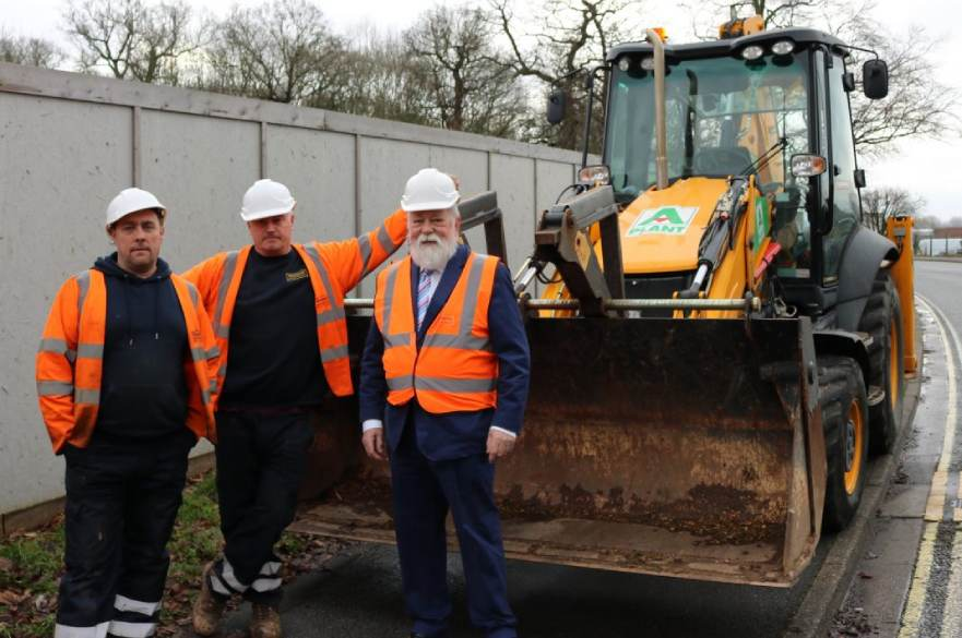 Digger at Moorways with Councillor and construction crew