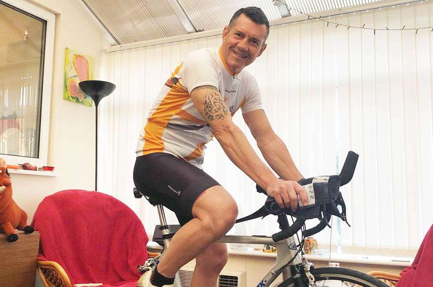 Fitness instructor on cycling machine
