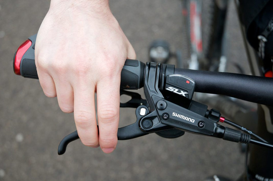 Hand on bicycle handlebar