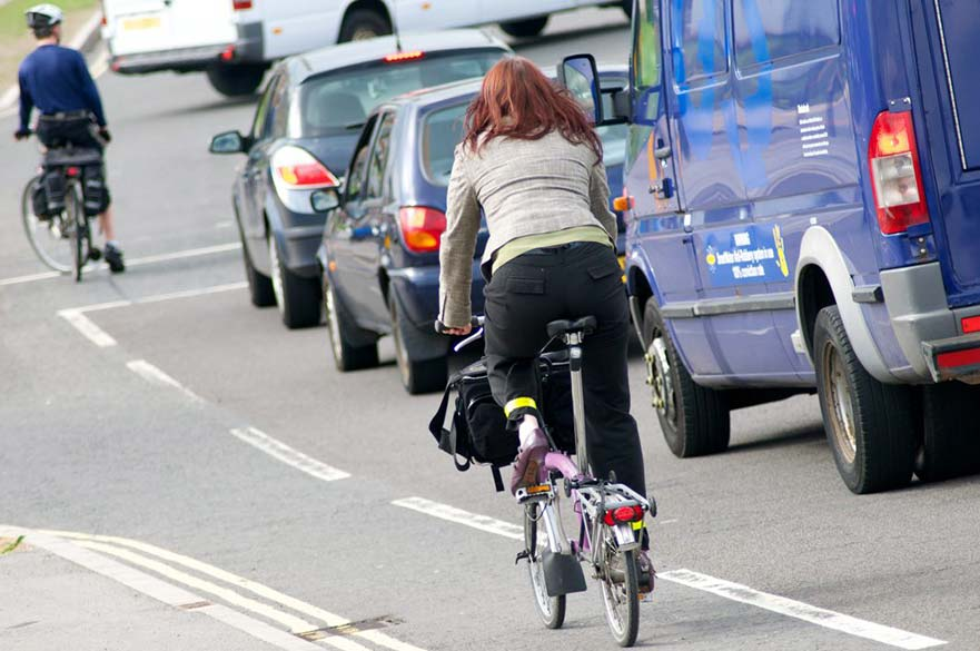 Woman riding fold up bike