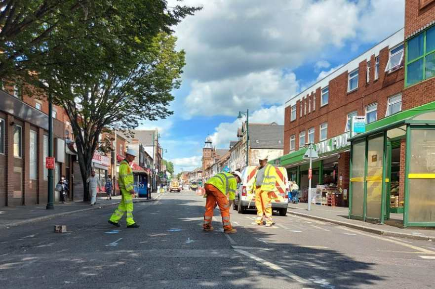 Workmen repairing Normanton Road