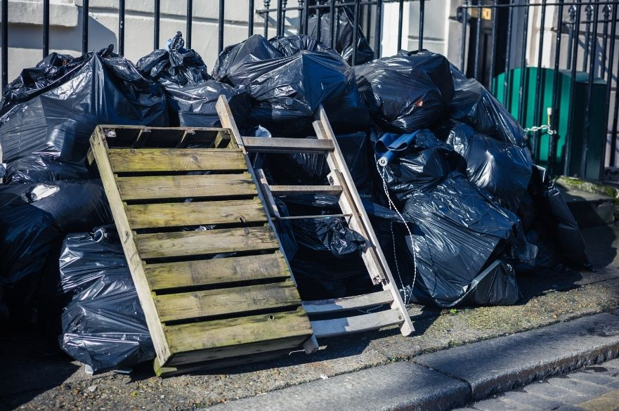 Pile of rubbish dumped outside building